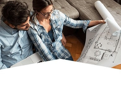 Couple looking at house plans