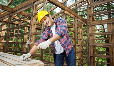 Construction worker smiling over home woodwork